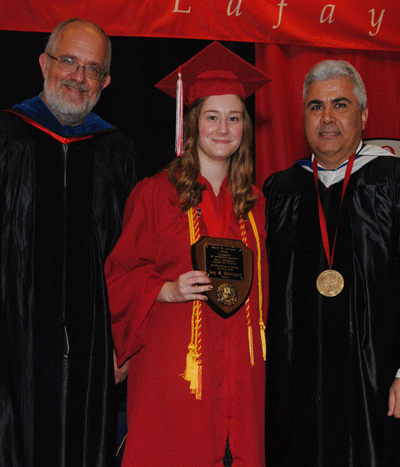 Amy Dekerlegand receiving the Spring 2015 David R. Andrew Scholar Award from Dr. Paul Leberg and Dean Ackleh