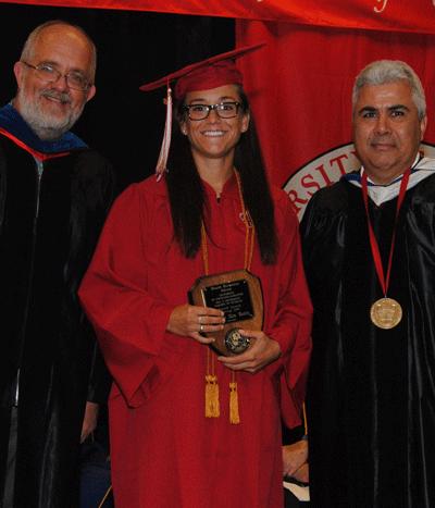Danielle Alex Dooley receiving the Spring 2015 Dean Duane Blumberg Spirit Award from Dr. Paul Leberg and Dean Ackleh