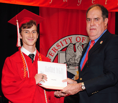 Gage Seaux receiving the Fall 2015 Ray P. Authement College of Sciences Outstanding Graduate Award from the Alumni Association representative