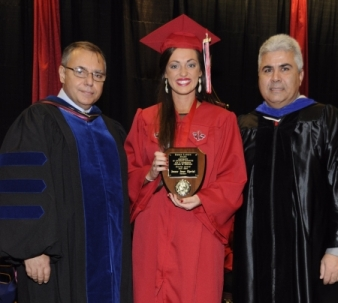 Jeanne Theriot receiving the Fall 2014 Sigred Lanoux Service Award from Dr. Thomas Junk and Dean Ackleh