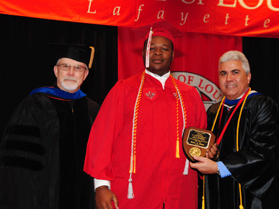 Uwem Sam Ekong receiving the Fall 2015 David R. Andrew Scholar Award from Dr. Jim Etheredge and Dean Ackleh