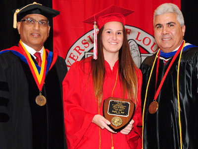 Taylor Kall receiving the Fall 2015 Dr. Sigred Lanoux Service Award from Dr. Durga Poudel and Dean Ackleh