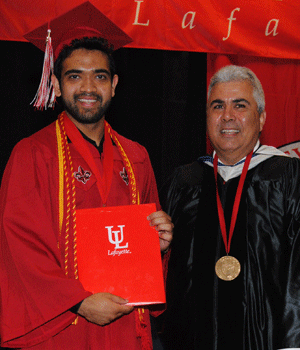 Zadid Haq receiving the Spring 2015 Ray P. Authement College of Sciences Outstanding Graduate Award from Dean Ackleh