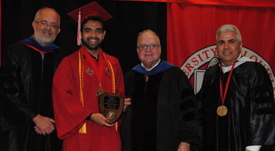 Zadid Haq receiving the Bradd Clark Excellence in Undergraduate Research Award from Dr. Paul Leberg, Dean Emeritus Bradd Clark, and Dean Azmy Ackleh